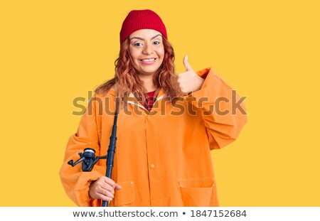 happy friends with fishing rods showing thumbs up Stock photo © dolgachov