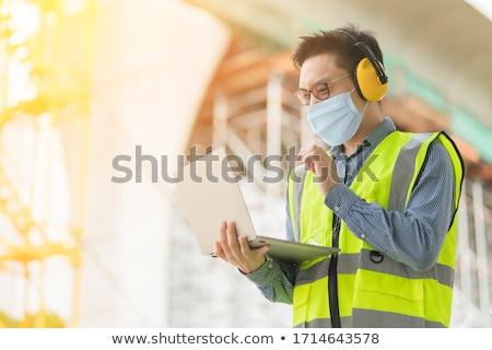 Geslaagd ingenieur helm werkkleding blauwdruk Stockfoto © pressmaster
