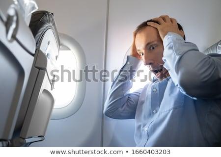 Férfi szorongás támadás repülőgép fiatalember utazás Stock fotó © AndreyPopov