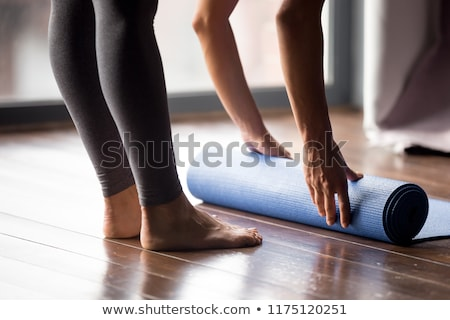 Close-up girl's foot in the leggings for yoga, which stands on the board with nails Stock photo © galitskaya