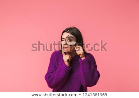 sorridente · menina · olhando · lupa · branco · cara - foto stock © dolgachov