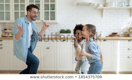 Man with three kids dancing stock photo © Paha_L