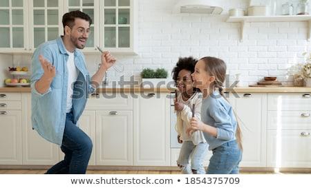 Man with three kids dancing stock photo © Paha_L