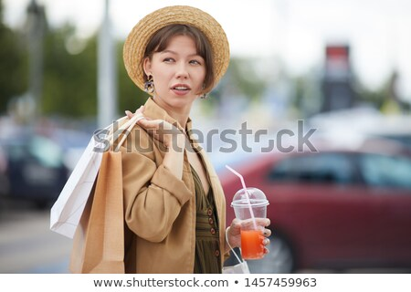 Woman carrying jacket over shoulder Stock photo © photography33