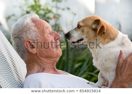Elderly man with dog Stock photo © ivonnewierink
