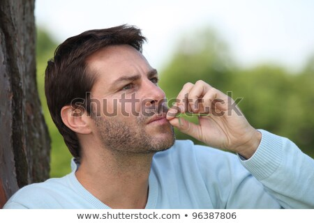 Man chewing ongrass Stock photo © photography33