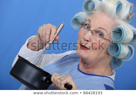 Cheeky older woman in rollers whisking sauce Stock photo © photography33