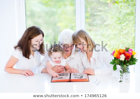 Senior and her granddaughter looking at photos Stock photo © photography33