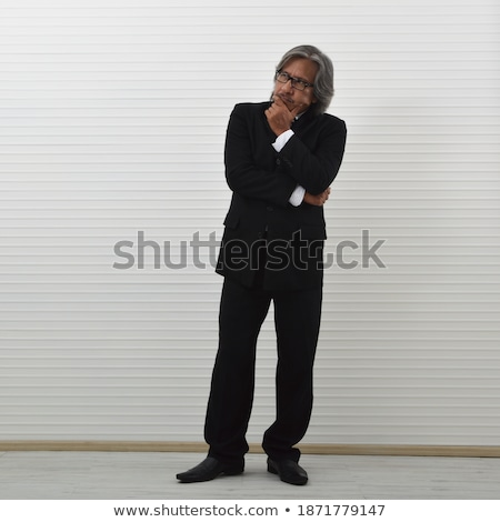 Businessman with his finger to his chin in thought Stock photo © photography33