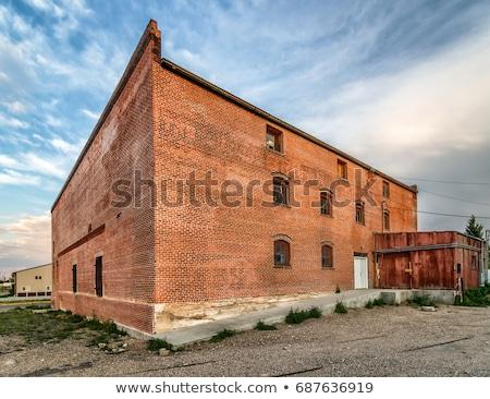 Starych cegły budynku niebo cztery Zdjęcia stock © bobkeenan