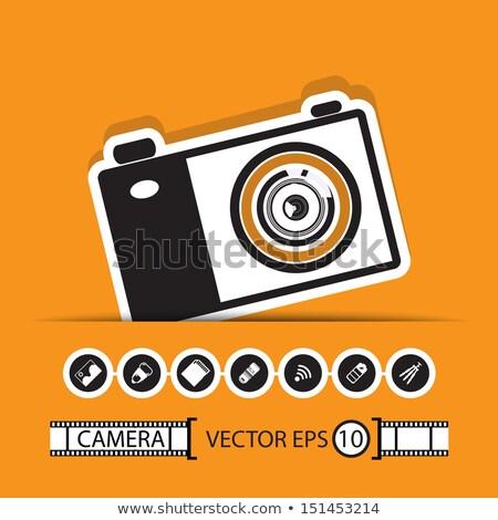 Digital slr camera and mini tripod  Stock photo © broker