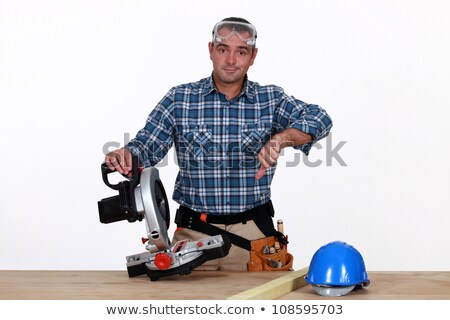 Thumbs down from a man with a circular saw Stock photo © photography33