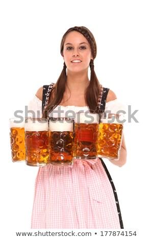Gyönyörű nő adag sör Oktoberfest fotó gyönyörű Stock fotó © sumners