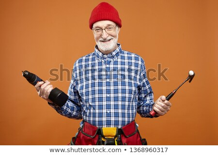 picture of mature carpenter holding drill stock photo © photography33