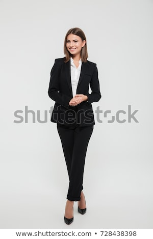 The young beauty woman in a black suit. Isolated on a white stock photo © acidgrey