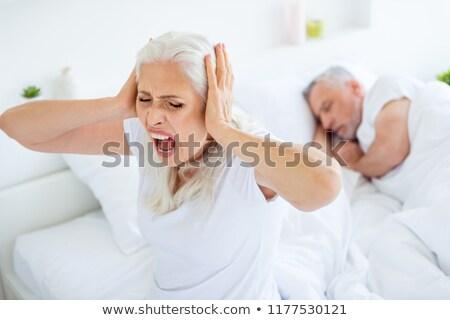 Woman not wanting to hear snoring in the bedroom Stock photo © wavebreak_media
