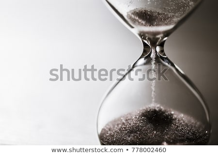 Sand Falling in Hourglass Close Up Stock photo © cboswell