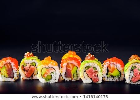 Sushi rolar peixe pepino gergelim preto e branco Foto stock © Elmiko
