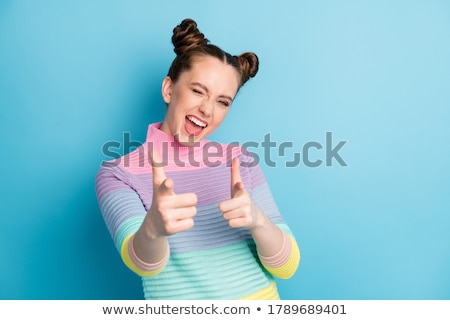 pretty brunette in trendy wear pointing you out stock photo © stockyimages
