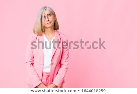 Portrait of a smiling businesswoman thinking against a white background stock photo © wavebreak_media