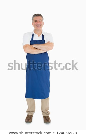 Laughing man dressed in blue apron  Stock photo © wavebreak_media