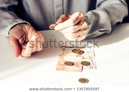 old hands with dollar symbol stock photo © sqback