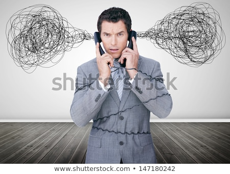 Man looking confused holding two mobile telephones Stock photo © photography33