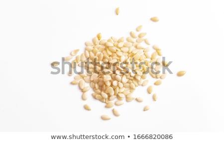 Stok fotoğraf: Closeup Of Sesame Seeds Isolated On White