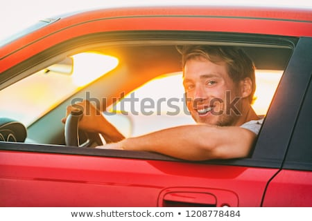 Car owner - young man and new red car outside Stock photo © Maridav