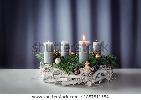 One white candle at grey background Stock photo © olandsfokus