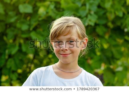 Meisje verlegen glimlach portret mooi meisje geïsoleerd Stockfoto © iko