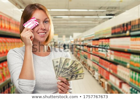 Pretty blonde showing wad of cash Stock photo © wavebreak_media