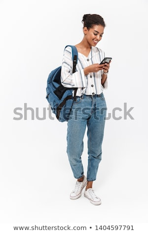 Full length portrait of a happy girl holding backpack Stock photo © deandrobot