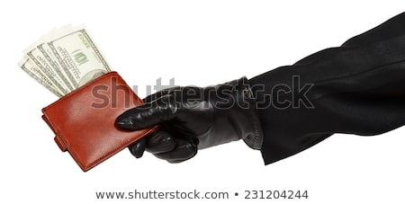 Thief in black suit holding a brown leather purse with dollars Stock photo © GeniusKp