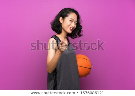 smiling fitness woman holding basketball ball stock photo © deandrobot
