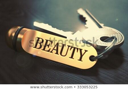 Szépség köteg kulcsok szöveg arany fekete Stock fotó © tashatuvango