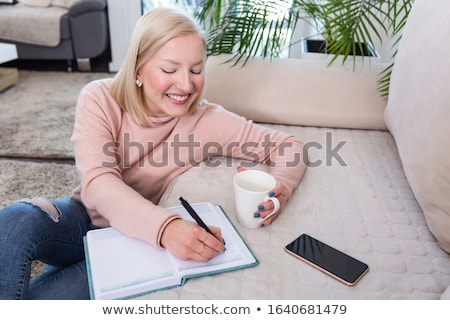 Woman drinking coffee and writing letters Stock photo © stevanovicigor