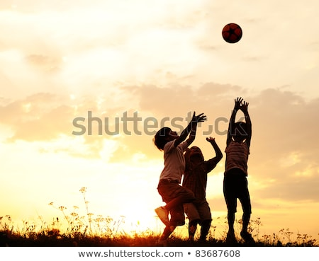 children playing in sunset with ball silhouettes freedom and happiness stock photo © zurijeta