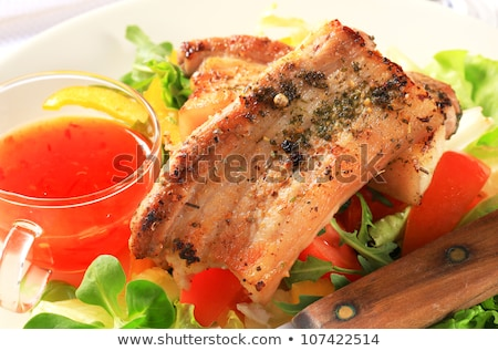 Stock photo: Tomato dipping sauce and herb-rubbed pork meat