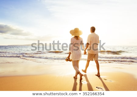 Couple in Sunset by the shore Stock photo © stockfrank