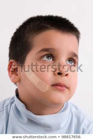 Kid with injury on his face Stock photo © zurijeta