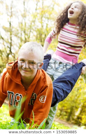Two boys playing wheel barrow race Stock photo © bluering