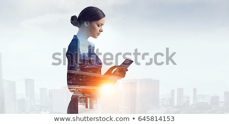 Stock photo: successful lady in city
