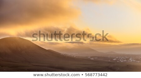 sunrise in Femes with extinguished volcanoes Stock photo © meinzahn