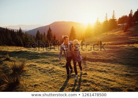 Naplemente meleg fény hegycsúcs tájkép hó Stock fotó © maxmitzu