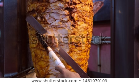 Closeup picture of stacked meat roasting, shawarma Stock photo © Nobilior
