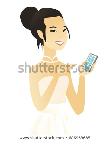 Asian fiancee holding a mobile phone. Stock photo © RAStudio