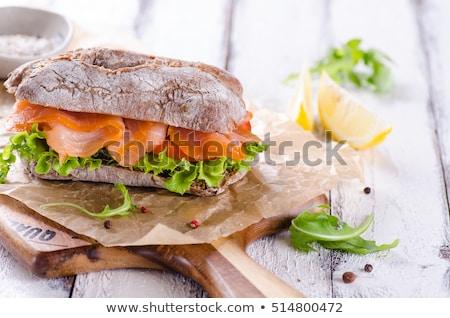 Szendvics füstölz lazac francia kenyér zsemle paradicsom ebéd Stock fotó © Digifoodstock