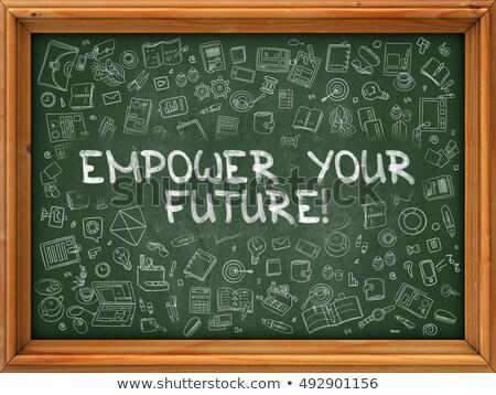 Hand Drawn Empower Your Future on Green Chalkboard. Stock photo © tashatuvango