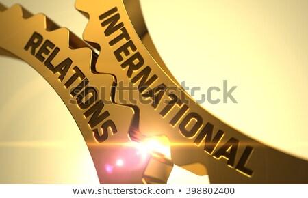 International Relations Concept. Golden Gears. Stock photo © tashatuvango